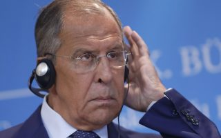 Russia's Foreign Minister Sergey Lavrov, listens to the translation during a joint new conference with Turkey's Foreign Minister Mevlut Cavusoglu, in Ankara, Turkey, Tuesday, Aug. 14, 2018. (AP Photo/Burhan Ozbilici)