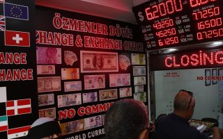 People wait their turn at a currency exchange shop in Istanbul, Monday, Aug. 13, 2018. Turkey's central bank announced a series of measures on Monday to free up cash for banks as the country grapples with a currency crisis sparked by concerns over President Recep Tayyip Erdogan's economic policies and a trade and diplomatic dispute with the United States. (AP Photo/Lefteris Pitarakis)
