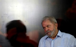 epa06473730 Former Brazilian President Luiz Inacio Lula da Silva reacts during a meeting in Sao Paulo, Brazil, 25 January 2018. The Workers Party (PT) began a meeting to reaffirm the candidacy of former president Luiz Inacio Lula da Silva, convicted in the second instance for corruption.  EPA/Fernando Bizerra