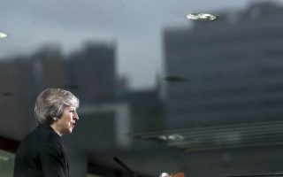 British Prime Minister Theresa May gives her speech at the Waterfront Hall, in Belfast, Northern Ireland, Friday, July 20, 2018. (Bryan Lawless/PA via AP).