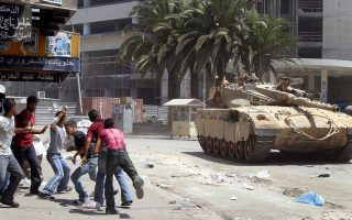 Palestinian youths hurl stones at an Israeli tank during clashes in the West Bank city of Nablus August 28, 2003.Palestinian President Yasser Arafat, under pressure to help save a Middle East peace plan, urged militants to reinstate a truce cancelled after Israel assassinated a Hamas leader.  . REUTERS/Abed Omar Qusini REUTERS