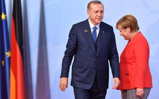 epa06149841 (FILE) - German Chancellor Angela Merkel (R) and Turkish President Recep Tayyip Erdogan (L) at the official reception to the opening day of the G20 summit in Hamburg, Germany, 07 July 2017 (reissued 18 August 2017). According to news reports on 18 August 2017, Erdogan urged Turkish voters in Germany not to vote for the three main political parties Christian Democratic Union (CDU), the Social Democratic Party (SPD) and the Green Party (Buendnis 90/Die Gruenen) in the upcoming federal elections on 24 September.  EPA/LUKAS BARTH