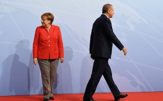 FILE PHOTO: German Chancellor Angela Merkel greets Turkey's President Recep Tayyip Erdogan at the beginning of the G20 summit in Hamburg, Germany, July 7, 2017. REUTERS/Bernd Von Jutrczenka/POOL/File Photo