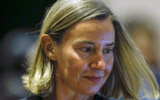 EU Foreign Policy chief Federica Mogherini arrives for the ASEAN-European Union Ministerial Meeting on the sidelines of the 51st ASEAN Foreign Ministers Meeting in Singapore, Friday, Aug. 3, 2018. (AP Photo/Yong Teck Lim)