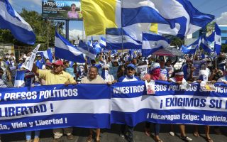 Demonstrators march with flags and banners demanding justice, life, and liberty, during an anti-government protest in Managua, Nicaragua, Saturday, Aug. 11, 2018. The current unrest began in April, when President Daniel Ortega imposed cuts to the social security system and small protests by senior citizens were violently broken up. From then more than 300 persons have died and demonstrators have demanded that Ortega leave power. (AP Photo/Alfredo Zuniga)