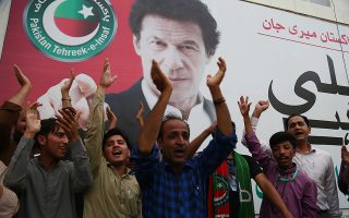epa06954426 Supporters of Imran Khan, head of Pakistan Tehrik-e-Insaf (PTI) celebrate as the National assembly (lower house of the parliament) elects Imran Khan, as the Prime Minister, in Karachi, Pakistan, 17 August 2018. PTI that emerged as the largest party in general elections, got its chairman Imran Khan elected as the 22nd Prime Minister of the Pakistan.  EPA/SHAHZAIB AKBER