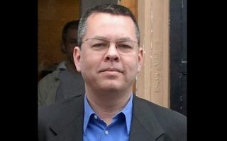 "FILE - In this undated file photo, Andrew Brunson, an American pastor, stands in Izmir, Turkey. The trial of an American pastor imprisoned in Turkey, whose case is part of the quagmire of tense relations between Washington and Ankara, is set to begin Monday, April 16, 2018 in western Izmir province. Andrew Craig Brunson, an evangelical pastor from North Carolina, is facing 35 years in prison on the charges of ""committing crimes on behalf of terror groups without being a member"" and ""espionage."" (DHA-Depo Photos via AP, File)"