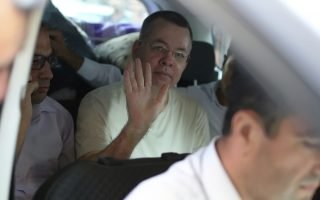 Andrew Craig Brunson, an evangelical pastor from Black Mountain, North Carolina, waves from a car as he arrives at his house in Izmir, Turkey, Wednesday, July 25, 2018 An American pastor who had been jailed in Turkey for more than one and a half years on terror and espionage charges was released Wednesday and will be put under house arrest as his trial continues. Andrew Craig Brunson, 50, an evangelical pastor originally from Black Mountain, North Carolina, was let out of jail to serve home detention because of