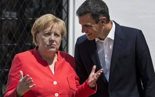 Spain's Prime Minister Pedro Sanchez, right, speaks with German Chancellor Angela Merkel at the Guzmanes Palace in Sanlucar de Barrameda, southern Spain, Saturday Aug. 11, 2018, prior to talks at the Donana National Park. (AP Photo/Javier Fergo)