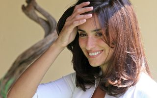 Spanish actress Penelope Cruz smiles as she leaves a photocall to promote her latest film
