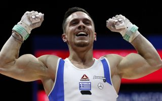 Eleftherios Petrounias of Greece after winning the gold medal in the rings during the men's artistic gymnastics finals at the European Championships in Glasgow, Scotland, Sunday, Aug. 12, 2018. (AP Photo/Darko Bandic)