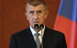 FILE- In this file photo dated Wednesday, June 6, 2018, newly appointed Prime Minister Andrej Babis addresses the media at the Prague Castle in Prague, Czech Republic.  A new coalition government was sworn in to office Wednesday June 27, 2018, led by billionaire Andrej Babis. (AP Photo/Petr David Josek, FILE)