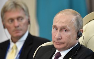 Russian President Vladimir Putin and presidential spokesman Dmitry Peskov, left, attend a meeting during the 5th Caspian summit in Aktau, the Caspian Sea port in Kazakhstan, Sunday, Aug. 12, 2018. (Alexei Nikolsky, Sputnik, Kremlin Pool Photo via AP)