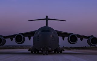 In this image provided by the U.S. Air Force, a C-17 Globemaster III, assigned to the 816th Expeditionary Airlift Squadron, conducts combat airlift operations for U.S. and coalition forces in Iraq and Syria on April 13, 2018. The drama of U.S. and allied missiles strikes on Syria has obscured the fact that the U.S.-led campaign to eliminate the Islamic State from Syria has stalled. This is an illustration of the many-layered complexities of the Syrian conflict.  (Tech. Sgt Gregory Brook/U.S. Air Force via AP)