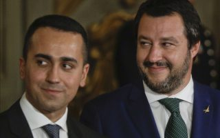 Leader of the League party, Matteo Salvini, right, stands by Luigi Di Maio, leader of the Five-Star movement, prior to the swearing-in ceremony for Italy's new government at Rome's Quirinale Presidential Palace, Friday, June 1, 2018. Italy's president is swearing in western Europe's first populist government, featuring a mix of anti-establishment and right-wing ministers along with some experienced figures who have served in previous governments. (AP Photo/Gregorio Borgia)