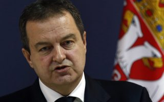 Serbian Foreign Minister Ivica Dacic speaks during a press conference after talks with his Russian counterpart Sergey Lavrov, in Belgrade, Serbia, Thursday, Feb. 22, 2018. Russia's foreign minister on Wednesday criticized Western policies toward his country, blasting the European Union for failing to maintain good relations with Moscow despite the divisions over Ukraine and many other issues. (AP Photo/Darko Vojinovic)