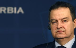 Serbian Foreign Minister Ivica Dacic listens to a question during a news conference with his Greek counterpart Nikos Kotzias, after their meeting in Belgrade, Serbia, Wednesday, April 11, 2018. Kotzias said that a compromise is needed in a decades-long dispute with Macedonia over the former Yugoslav republic's name. (AP Photo/Darko Vojinovic)