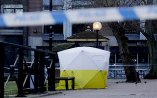 A police tent is framed by police tape covering the the spot where former Russian double agent Sergei Skripal and his daughter were found critically ill Sunday following exposure to an