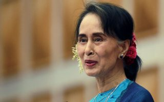 Myanmar's leader Aung San Suu Kyi smiles as she delivers a speech during a ceremony to mark the second year anniversary of the parliament in Naypyitaw, Myanmar, Thursday, Feb. 1, 2018. A Myanmar government spokesman says a petrol bomb was tossed into the residential compound of Suu Kyi, but she was not at home and damage was minor. (AP Photo/Aung Shine Oo)