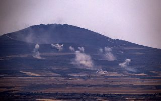 epa06892706 Smoke rises as a result of Russian air strikes on the Syrian side of the Golan Heights in Quneitra province, seen from the Israeli side of the border, 16 July 2018. According to reports, forces allied with the Syrian government started a military offensive to regain control over Quneitra Governorate in south-western Syria currently under control of various rebel factions, mainly Hay'at Tahrir al-Sham (HTS).  EPA/ATEF SAFADI