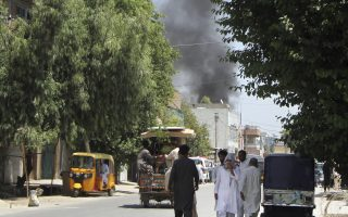 Smoke rises from a building after a deadly attack including a suspected suicide car bombing and gunbattles, in Jalalabad, Afghanistan, Tuesday, July 31, 2018. An Afghan provincial official said a coordinated attack was underway by the Taliban in the city of Jalalabad, the capital of eastern Nangarhar province. (AP Photo)