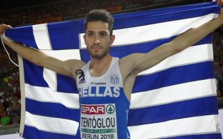 Greece's Miltiadis Tentoglou celebrates after winning the gold medal in the men's long jump final at the European Athletics Championships at the Olympic stadium in Berlin, Germany, Wednesday, Aug. 8, 2018. (AP Photo/Matthias Schrader)