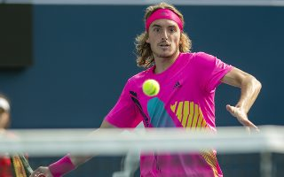 epa06944576 Stefanos Tsitsipas of Greece in action against Kevin Anderson of South Africa during their semifinal match at the Rogers Cup Men's Tennis tournament in Toronto, Canada, 11 August 2018.  EPA/WARREN TODA