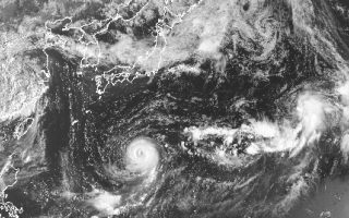 This satellite image taken Monday, July 31, 2017, and released by the National Oceanic and Atmospheric Administration shows Typhoon Noru. The powerful Pacific typhoon that intensified into the Northern Hemisphere's strongest storm of the year but has since lost some of its punch could still threaten Japan by this weekend. (NOAA via AP)