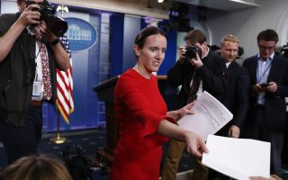 White House Deputy Press Secretary Lindsay Walters hands out a document to reporters in the briefing room of the White House, in Washington, Tuesday, May 9, 2017, containing comments by Senate Minority Leader Charles Schumer. President Donald Trump abruptly fired FBI Director Comey, ousting the nation's top law enforcement official in the midst of an investigation into whether Trump's campaign had ties to Russia's election meddling. (AP Photo/Carolyn Kaster)