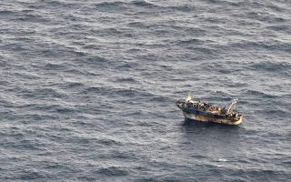 In this aerial image released by the Greek Coast Guard, immigrants crowd on the deck of a stranded fishing boat near Crete on Monday March 31, 2014.  The Greek Coast Guard transferred 331 immigrants, including 40 children and 24 women, from the stranded fishing boat to a crude oil tanker Monday after it made a distress call overnight. The transfer lasted several hours in moderate-to-rough seas between the islands of Crete and Kythira, the Merchant Marine Ministry said. (AP Photo/Hellenic Coast Guard)