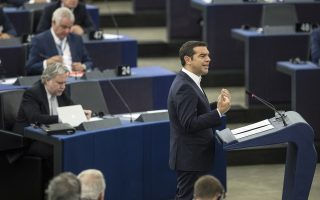 Greek Prime minister Alexis Tsipras debates the future of Europe with MEPs and commissioners at the European Parliament in Strasbourg, eastern France, Tuesday Sept.11, 2018. (AP Photo/Jean-Francois Badias)