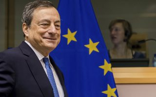 FILE - In this Nov. 12, 2015 file photo the President of the European Central Bank Mario Draghi arrives to address the committee on economic and monetary affairs at the European parliament in Brussels. (AP Photo/Geert Vanden Wijngaert, file)