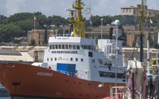 The Aquarius rescue ship enters the harbor of Senglea, Malta, Wednesday, Aug. 15, 2018. Malta agreed to let the private rescue ship dock on the island, with the 141 migrants it is carrying to be distributed among five European Union nations in what was described as a