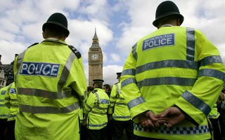 British police officers maintain a cordon during an anti-war demonstration outside the House of Parliament in London, Monday Oct. 9, 2006.  Police scuffled Monday with about 50 anti-war protesters demonstrating near the Houses of Parliament.  The demonstrators had planned to stop people from entering the Houses of Parliament as lawmakers returned from summer recess. (AP Photo/Matt Dunham)
