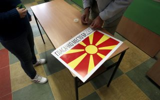 Polling organizers set up a polling station ahead of a referendum on Macedonia's name, in Skopje, Macedonia, Saturday, Sept. 29, 2018. Macedonians will vote Sunday in a referendum on whether to change the country's name to