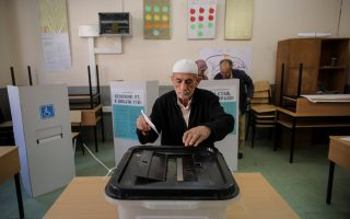 A man casts his ballot for the referendum in Macedonia on changing the country's name that would open the way for it to join NATO and the European Union in Skopje, Macedonia September 30, 2018. REUTERS/Marko Djurica
