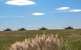 In this photo provided by Russian Defense Ministry Press Service on Tuesday, Sept. 11, 2018, tanks roll during the military exercises in the Chita region, Eastern Siberia, during the Vostok 2018 exercises in Russia. Russia's military chief of staff says that the military exercises expected to be the biggest in three decades, will involve nearly 300,000 troops. (Russian Defense Ministry Press Service pool photo via AP)