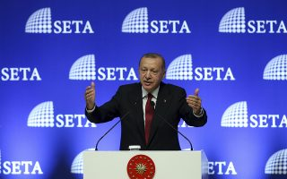 Turkey's President Recep Tayyip Erdogan gestures as he delivers a speech in Ankara, Turkey, Tuesday, Aug. 14, 2018. Erdogan said his country will boycott U.S.-made electronic goods amid a diplomatic spat that has helped trigger a Turkish currency crisis.The Turkish lira has nosedived in value in the past week over concerns about Erdogan's economic policies and after the United States slapped sanctions on Turkey angered by the continued detention of an American pastor. (Pool Photo via AP)
