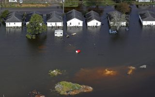 Floodwater from Hurricane Florence threatens homes in Dillon, S.C., Monday, Sept. 17, 2018. (AP Photo/Gerald Herbert)