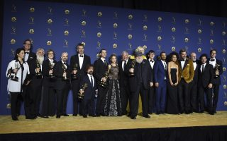 George R. R. Martin, center, and the cast and crew of