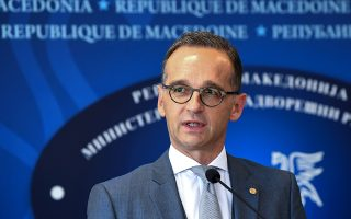 epa07030035 German Minister of Foreign Affairs Heiko Maas speaks at a joint press conference with Macedonian Foreign Minister Nikola Dimitrov (unseen) following their meeting at the Ministry of Foreign Affair in Skopje, The Former Yugoslav Republic of Macedonia (FYROM), on 18 September 2018. German Minister of Foreign Affairs Heiko Maas arrived in Skopje for a two days official visit to FYROM.  EPA/GEORGI LICOVSKI