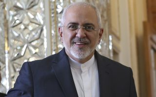 Iranian Foreign Minister Mohammad Javad Zarif arrives for a meeting with his North Korean counterpart Ri Yong Ho in Tehran, Iran, Tuesday, Aug. 7, 2018. (AP Photo/Vahid Salemi)