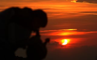 An amateur astronomer observes with his telescope the sun's eclipse in Athens on Saturday May 31, 2003 at 06.20 local time (03,20 GMT). Only 40 % of the eclipse was visible from Greece. (AP Photo/Dimitri Messinis)