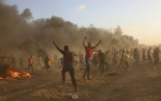 Protesters burn tires while trying to break the fence of Gaza Strip border with Israel during a protest east of Gaza City, Friday, Sept. 14, 2018. Gaza health officials say 3 Palestinians, including 12-year-old boy, were killed by Israeli army fire in protests along Gaza's perimeter fence. (AP Photo/Adel Hana)