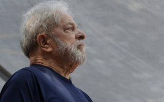FILE - In this April 7, 2018 file photo, former Brazilian President Luiz Inacio Lula da Silva looks on before speaking to supporters outside the Metal Workers Union headquarters in Sao Bernardo do Campo, Brazil. A Brazilian appeals court judge has ordered Da Silva released from jail on Sunday, July 8, 2018, but another judge has asked the police to hold off on the order. (AP Photo/Andre Penner, File)