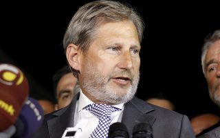 European Neighborhood Policy & Enlargement Negotiations commissioner Johannes Hahn talks to the media in presence of the four most relevant party leaders in Macedonia, after their talks in Skopje, Macedonia, early Wednesday, July 15, 2015. . (AP Photo/Boris Grdanoski)