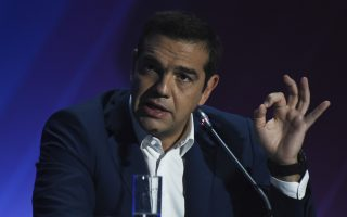Greece's Prime Minister Alexis Tsipras speaks to reporters during a news conference at Thessaloniki International Trade Fair, at the northern Greek city of Thessaloniki, Sunday, Sept. 9, 2018. Prime Minister Alexis Tsipras painted an optimistic vision Saturday night of a Greece that has emerged from eight years of financial austerity imposed by creditors and is on the road to economic recovery. (AP Photo/Giannis Papanikos)