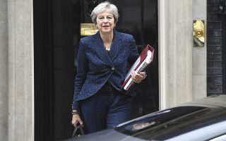 Britain's Prime Minister Theresa May leaves 10 Downing Street, ahead of Prime Minister's Questions, in London, Wednesday, Sept. 12, 2018.  A leading Brexit-supporting lawmaker insists rebels aren't about to topple Prime Minister Theresa May, despite strong opposition to her plan for taking Britain out of the European Union. (Kirsty O'Connor/PA via AP)