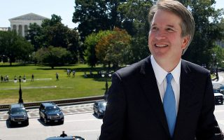 FILE PHOTO:    With the U.S. Supreme Court building in the background, Supreme Court nominee judge Brett Kavanaugh arrives prior to meeting with Senate Majority Leader Mitch McConnell on Capitol Hill in Washington, U.S., July 10, 2018. REUTERS/Joshua Roberts/File Photo