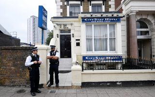 Police officers stand outside the City Stay Hotel used by Alexander Petrov and Ruslan Boshirov; who have been accused of attempting to murder former Russian spy Sergei Skripal and his daughter Yulia; in London, Britain September 5, 2018. REUTERS/Toby Melville